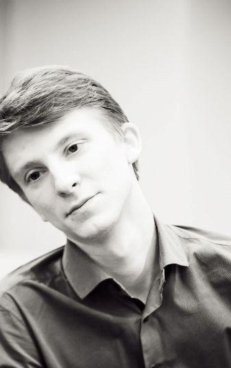 Михаил Комин